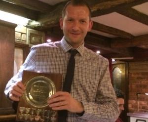 Rob Hewlitt with the prestigious Fielder of the Year trophy.