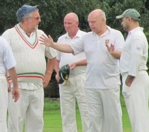 Tim demonstrates to team mates how far outside off stump the ball that he was given out lbw to had pitched.